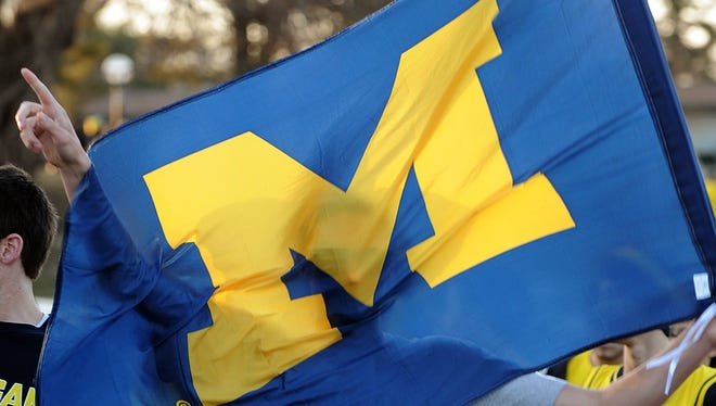 Michigan students show their colors outside Crisler Center on Monday.
