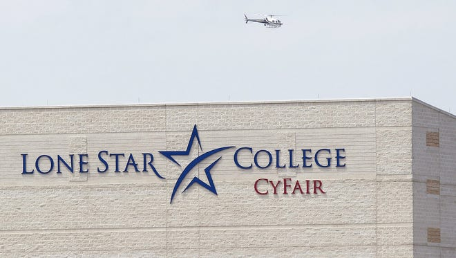 A police helicopter circles the Cy-Fair campus of Lone Star Community College.