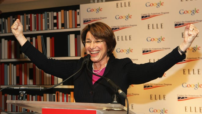 Sen. Amy Klobuchar, D-Minn., attends a celebration for women leaders in Washington hosted by Google, Elle and the Center for American Progress on Jan. 20, 2013, in Washington.