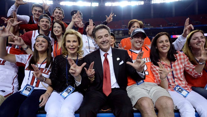 Rick Pitino celebrates with his family after winning the NCAA championship.
