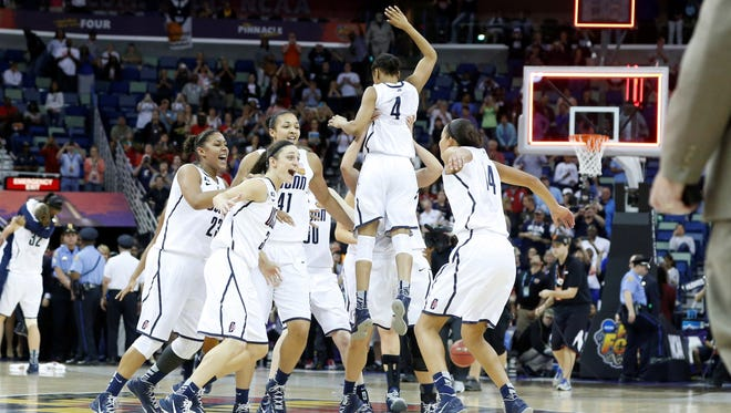 The Connecticut Huskies celebrate after the championship game in the 2013 NCAA womens Final Four against the Louisville Cardinals at the New Orleans Arena.