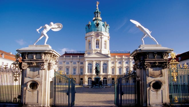 Healthy competition among hostels and cheaper hotels keeps Berlin's budget accommodations inexpensive. Even when you factor in food and activities, Berlin remains a bargain, with an average daily cost of $108 per traveler. Here, an open entrance gate invites tourists into the courtyard of the Charlottenburg Palace in Berlin.