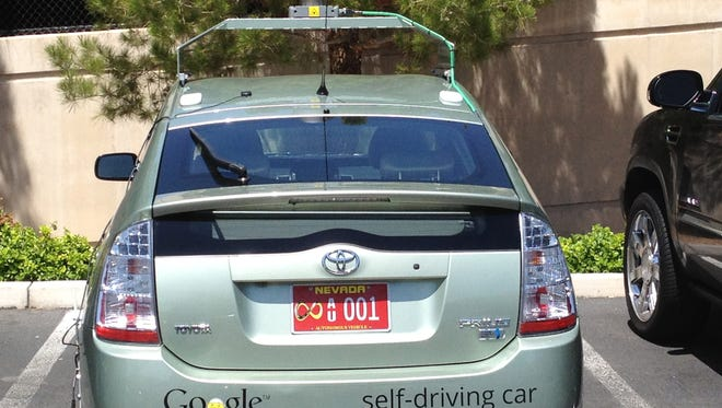 This handout image provided by the New Mexico Department of Motor Vehicles(NMDMV) on May 7, 2012, shows the first officially licensed Google self-driving car, a Toyota Prius hybrid.