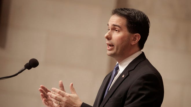Wisconsin Gov. Scott Walker delivers his state budget address at the state Capitol in Madison, Wis., on Feb. 20.