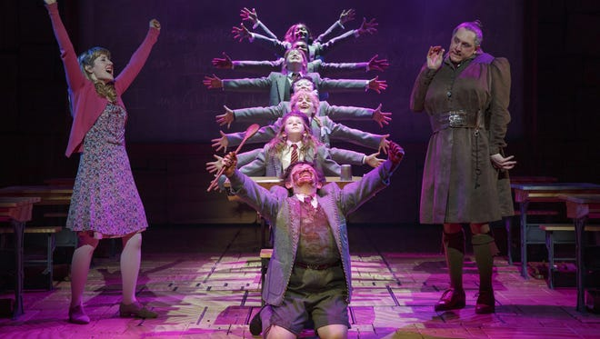 The cast of 'Matilda the Musical,' including Bertie Carvel, right, and Lauren Ward, left, during a performance in New York.