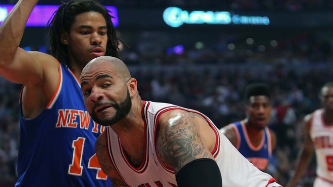 Chicago Bulls power forward Carlos Boozer (5) is defended by New York Knicks small forward Chris Copeland (14) during the first quarter at the United Center.