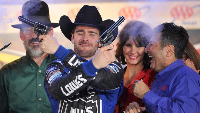 Jimmie Johnson partakes in the customary celebration after winning at Texas Motor Speedway in November.