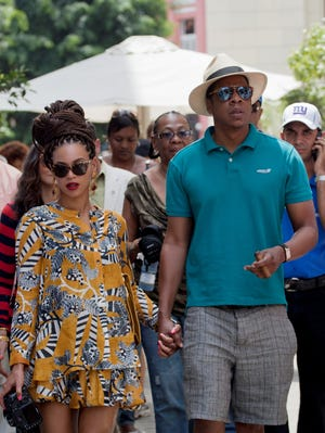 Beyonce and Jay-Z tour Old Havana, Cuba.