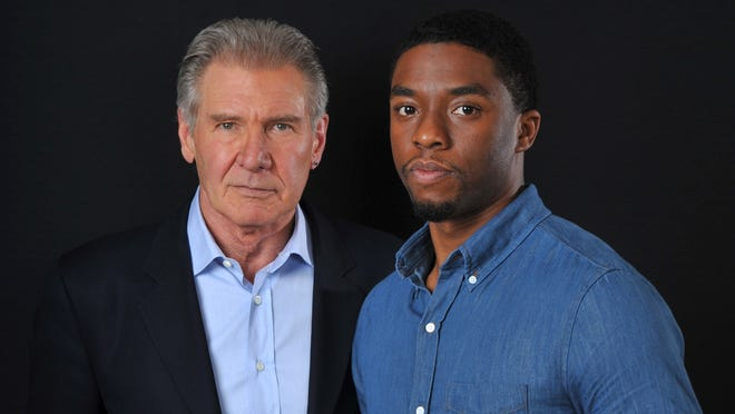 Harrison Ford and Chadwick Boseman play Dodgers President Branch Rickey and Jackie Robinson in 42.