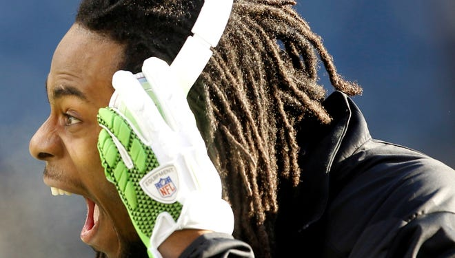 Seattle Seahawks cornerback Richard Sherman  warms up before a game against the St. Louis Rams at CenturyLink Field in December.