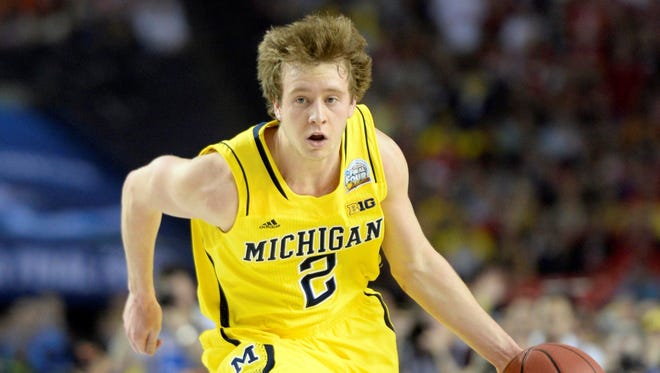 Michigan guard Spike Albrecht scored 17 points in the first half of the NCAA men's title game against Louisville.