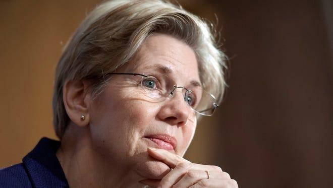 Sen. Elizabeth Warren, D-Mass., listens to a witness at a Senate Banking Committee hearing on March 7, 2013.