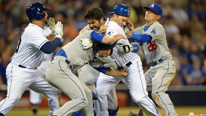 Padres left fielder Carlos Quentin (middle right) and Dodgers starting pitcher Zack Greinke (middle left) tangle as Dodgers catcher A.J. Ellis (17) and shortstop Justin Sellers (28) and Padres first baseman Yonder Alonso (left) join in the bench clearing fight.