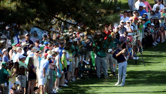 Adam Scott hits from the rough of the 10th hole.