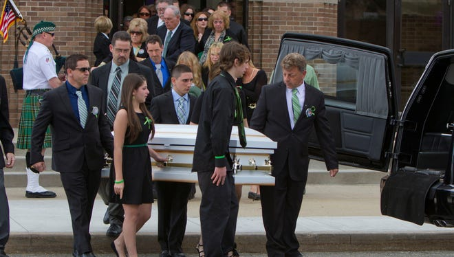 Pallbearers including Skyler Watkins and Ronald Holt, right, carry the casket of Brandon Holt, 6, out of St. Joseph Church at the conclusion of the funeral ceremony on Saturday, April 13, 2013.