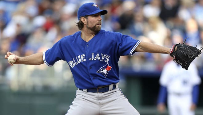 R.A. Dickey delivers in the first inning Saturday against the Royals.