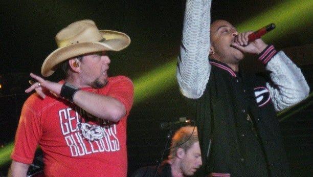 Jason Aldean, left, and Ludacris perform 'Dirt Road Anthem'  at the University of Georgia's Sanford Stadium in Athens, Ga.