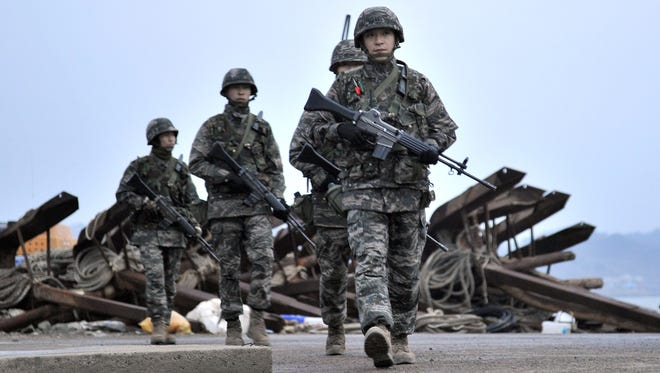 South Korean soldiers patrol on the island of Yeonpyeong near the disputed waters of the Yellow Sea at dawn on Sunday.