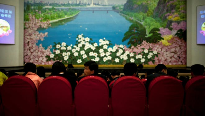 A man looks back on his seat while waiting for a performance to celebrate the upcoming birthday of the late leader Kim Il Sung on Sunday at a theater in Pyongyang, North Korea.
