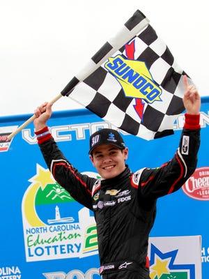 Kyle Larson celebrates after winning Sunday's NASCAR Camping World Truck Series race in Rockingham, N.C.