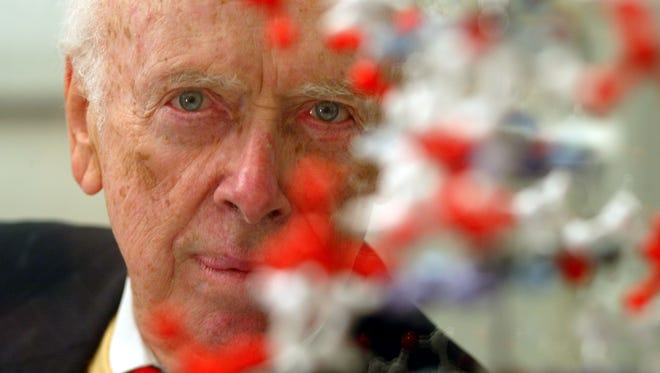Co-discoverer James Watson behind a model of the DNA double helix.