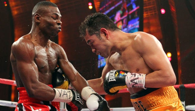 Nonito Donaire (right) slams a right hand into the ribs of Guillermo Rigondeaux Saturday night, but his power punches landed were few and far between as Rigondeaux won a unanimous decision.