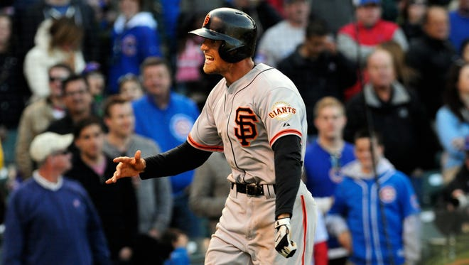 San Francisco Giants right fielder Hunter Pence (8) rounds the bases after hitting a tying home run in the ninth inning against the Chicago Cubs at Wrigley Field. The Giants won 10-7 in 10 innings.