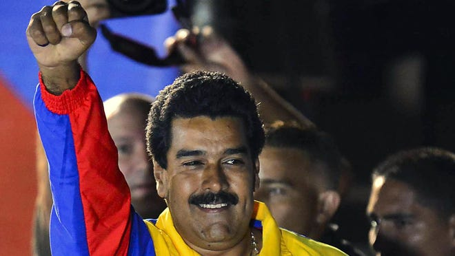 Venezuelan-elected President Nicolas Maduro celebrates following the election results in Caracas on Sunday.