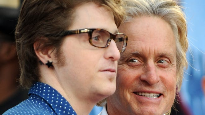 "Actor Michael Douglas arrives with his son Cameron Douglas for the world premiere of ""Ghosts of Girlfriends Past"" at the Grauman's Chinese Theater in Hollywood, California, on April 27, 2009. A New York City judge sentenced Cameron Douglas on April 20, 2010 to five years in prison for dealing methamphetamine and cocaine."