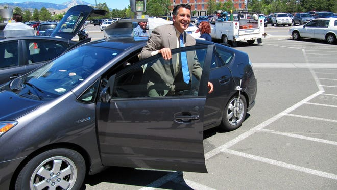 Nevada's governor, Brian Sandoval, takes a spin in a driverless car July 20, 2011 in Carson City, Nev. Sandoval described the experience as amazing; his state was the first to OK the concept.