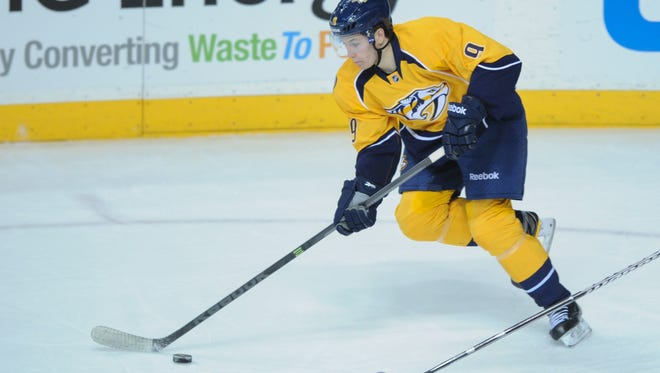 Nashville Predators center Filip Forsberg skates with the puck during the third period on Sunday.