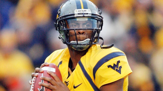 West Virginia Mountaineers quarterback Geno Smith looks to pass against the TCU Horned Frogs during the fourth quarter at Milan Puskar Field in November.