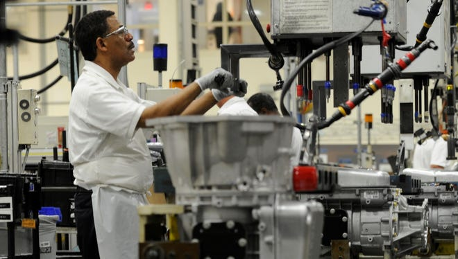 GM Baltimore Operations worker Johnny Johnson works on the final assembly of A1000 Heavy Duty transmissions in White Marsh, Md., in this 2011 photo.