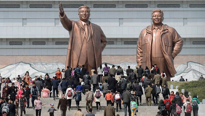People visit giant statues of the late North Korean leaders, Kim Il Sung, left, and his son Kim Jong Il, in Pyongyang, North Korea, Monday, April 15, 2013. Oblivious to international tensions over a possible North Korean missile launch, Pyongyang residents spilled into the streets Monday to celebrate a major national holiday, the birthday of their first leader, Kim Il Sung. (AP Photo/Kyodo News) JAPAN OUT, MANDATORY CREDIT, NO LICENSING IN CHINA, HONG KONG, JAPAN, SOUTH KOREA AND FRANCE ORG XMIT: TOK817