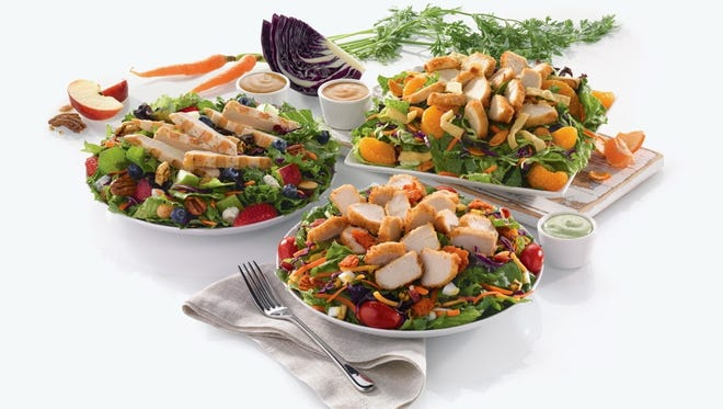Chick-fil-A's new premium salads include, from left, the Grilled Market Salad, Cobb Salad and Asian Salad.
