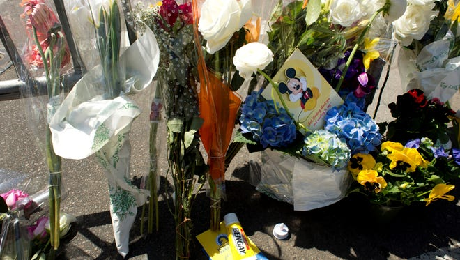A tube of Bengay, a pain relief medicine, and flowers are left at a memorial site at Boylston and Arlington streets along the course of the Boston Marathon on Tuesday. The site is a few blocks from where two explosions struck near the finish line on Monday.