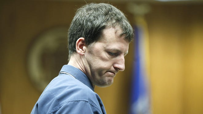 Aaron Schaffhausen makes his way out of the St. Croix County Courtroom, on April 12, 2013, in Hudson, Wis.