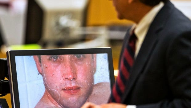 Prosecutor Juan Martinez asks Jodi Arias about a photo she took of Travis Alexander in the shower, moments before she shot him, stabbed him and slit his throat on Feb. 28, 2013. The photo was the focus of a hearing on April 15, 2013.