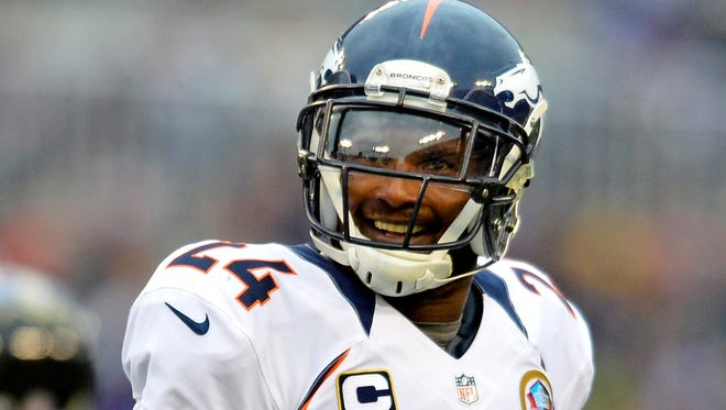 Denver Broncos cornerback Champ Bailey  reacts as he leaves the field after a turn over on downs against the Baltimore Ravens in the third quarter of the December 2012 game at M&T Bank Stadium.The Broncos defeated the Ravens 34-17.