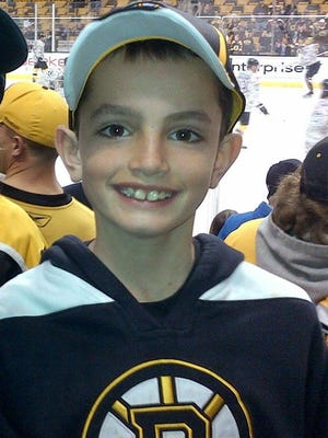 A family photo shows Martin Richard, 8, at a hockey game. Martin was killed Monday when dual explosions went off at the finish line of the Boston Marathon, where Martin and his family were spectators.