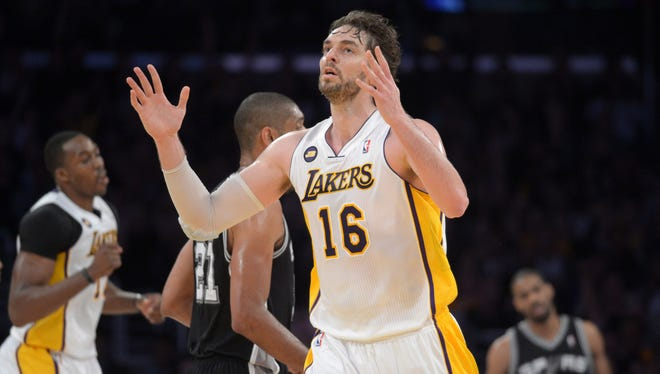 Lakers forward Pau Gasol (16) celebrates after making a three-point basket in the 91-86 win Sunday against the San Antonio Spurs.