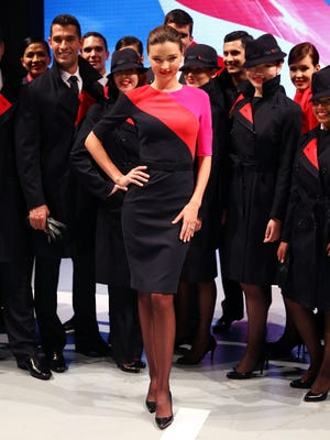 Miranda Kerr showcases the Qantas uniform alongside Qantas staff at Hordern Pavilion on Tuesday in Sydney.
