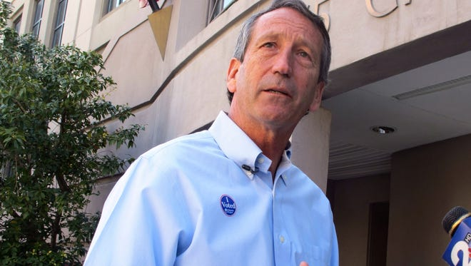 Former South Carolina governor Mark Sanford answers questions from reporters after voting in Charleston, S.C., on April 2.