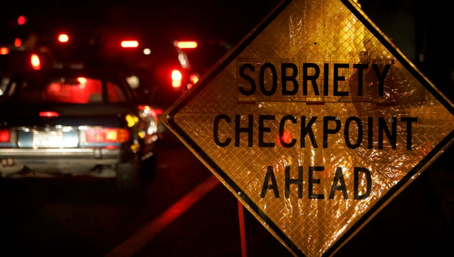 A sobriety checkpoint traffic stop is conducted in Fresno, Calif.