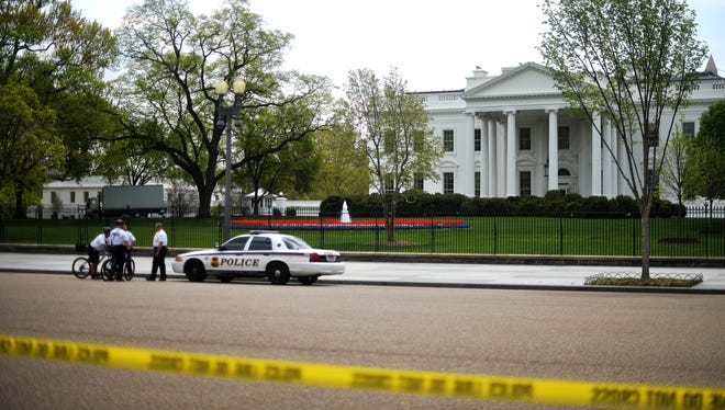 Members of U.S. Secret Service Uniformed Division secure an area in front of the White House on April 17 as part of tightened security following the Boston marathon bomb blasts.