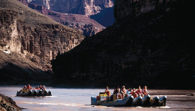 Tourists float along Colorado River in the Grand Canyon in Arizona in 1992. A $26 billion recreation economy relies on the Colorado River.