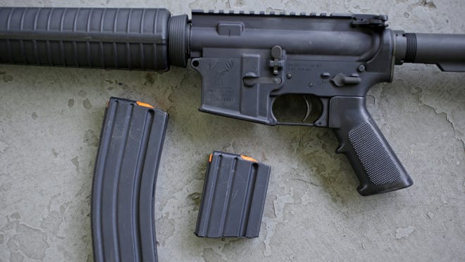 A Stag Arms AR-15 rifle with 30-round and and 10-round magazines