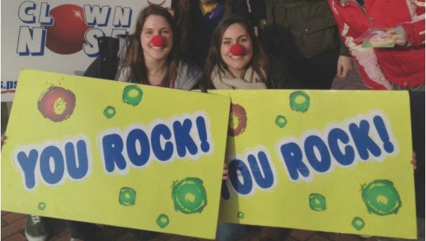 Penn State's Clown Nose Club has nothing to do with clowns, except making passersby happy.