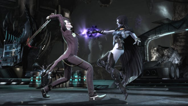 The Joker, left, fights Raven in 'Injustice: Gods Among Us.'