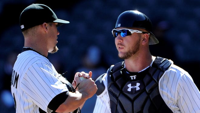 """White Sox catcher Tyler Flowers, talking with reliever Matt Lindstrom, knows replacing A.J. Pierzynski won't be easy. But, staff ace Chris Sale says, """"He's been ready for this opportunity for a while."""""""